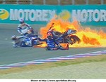 Crash Proton KR3, Jamie Whitham crash & fire at '99 Czech 500 GP, Brno. The race was red flagged, the bike fire caught the tire barriers on fire and burned the track, pretty crazy.