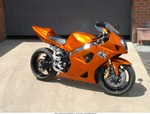 Production (Custom) Suzuki GSX-R1000, this is my friends 2003 gsxr1000. it was the blue and white paint scheme. he painted it candy orange pearl and added a hyperformance exhaust and undertail..
