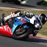 Misc. Racing Suzuki GSX-R1000, a person riding a motorcycle on a track a person riding a Suzuki GSX-R1000 Sportbike on a track