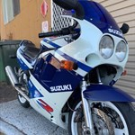 Production (Stock) Suzuki GSX-R1100, a motorcycle parked on the side of the road a Suzuki GSX-R1100 Sportbike parked on the side of the road