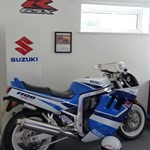 Production (Stock) Suzuki GSX-R1100, a motorcycle parked on the side of the room a Suzuki GSX-R1100 Sportbike parked on the side of the room