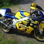 Production (Stock) Suzuki GSX-R600, a yellow and blue motorcycle parked on the grass a yellow and blue Suzuki GSX-R600 Sportbike parked on the grass