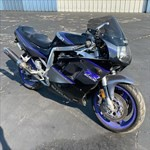 Production (Stock) Suzuki GSX-R750, a motorcycle parked on the side of a road