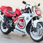 Production (Stock) Suzuki RGV250, a motorcycle parked on the side