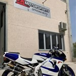 Production (Stock) Suzuki RGV250, a motorcycle parked on the side of a building