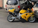 Production (Stock) Suzuki TL1000R/TL1000S, a motorcycle parked in a parking lot a Suzuki TL1000R/TL1000S Sportbike parked in a parking lot
