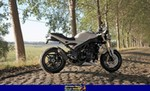 Production (Stock) Triumph Speed Triple, 2006 TRIUMPH SPEED TRIPLE a 2006 Triumph Speed Triple sportbike parked on the side of a dirt field