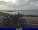 Production (Stock) Triumph Speed Triple, 2015 TRIUMPH SPEED TRIPLE a 2015 Triumph Speed Triple sportbike parked next to a body of water