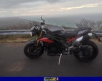 Production (Stock) Triumph Speed Triple, 2015 TRIUMPH SPEED TRIPLE a 2015 Triumph Speed Triple sportbike parked on the side of a road
