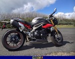 Production (Stock) Triumph Speed Triple, 2016 TRIUMPH SPEED TRIPLE a 2016 Triumph Speed Triple sportbike parked on the side of a road