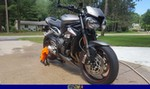 Production (Stock) Triumph Speed Triple, 2018 Street Triple RS 1 a 2018 Triumph Speed Triple sportbike parked on the side of a road