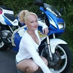 Women Suzuki RGV250, Hot babe with a Suzuki RGV250 motorcycle! a woman sitting on a 1993 Suzuki RGV250 sportbike