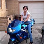 Women Kawasaki Ninja ZX-9R, Hot babe with a Kawasaki ZX-9R motorcycle! a person sitting on a 1999 Kawasaki Ninja ZX-9R sportbike in front of a building