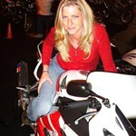 Women Honda CBR929RR/CBR954RR, GF on my 929 at the Midnight Run in Chicago on July 12th. Had a great time! a person wearing a red 2000 Honda CBR 929/954 RR sportbike