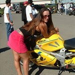 Women Suzuki TL1000R/TL1000S, a person standing next to a yellow Suzuki TL1000R/S sportbike