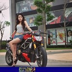 Women Ducati Streetfighter, a person riding on a Ducati Streetfighter