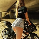 Women Kawasaki Ninja ZX-6R, A woman posing with a motorcycle. a person riding on a Kawasaki ZX-6 and ZZR600 Sportbike