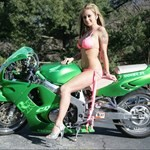 Women Honda CBR900RR, Hot babe with a Honda CBR900RR motorcycle! a woman with a green 1996 Honda CBR900RR sportbike parked on the side of a road