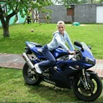 Women Yamaha YZF-R1, Hot babe with a Yamaha YZF-R1 motorcycle! a person sitting on a 1999 Yamaha YZF-R1 sportbike