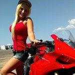 Women Ducati 1199/1299 Panigale, A woman wearing a red shirt with a Ducati 1199 Panigale sportbike