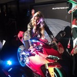 Women Ducati 1199/1299 Panigale, ducati 1199 girl babe 2 a person sitting on a Ducati 1199/1299 Panigale
