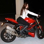Women Ducati Streetfighter, Hot babe with a Ducati Streetfighter motorcycle! a woman sitting on a Ducati Streetfighter sportbike