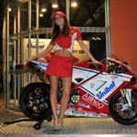 Women Ducati 1199/1299 Panigale, a woman standing next to a Ducati 1199/1299 Panigale sportbike