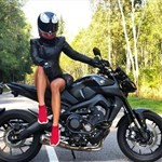 Women Yamaha MT-09, a person sitting on a motorcycle a person sitting on a Yamaha MT-09 Sportbike