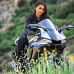 Women Yamaha YZF-R1, a person riding on the back of a motorcycle a person riding on a Yamaha YZF-R1 Sportbike