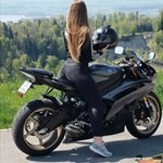 Women Yamaha YZF-R6, a motorcycle parked on the side of a road a Yamaha YZF-R6 Sportbike parked on the side of a road