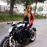 Women MV Agusta Brutale series, a motorcycle parked on the side of a road a MV Agusta Brutale series Sportbike parked on the side of a road