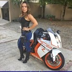 Women KTM 1190 RC8, a woman sitting on a motorcycle a woman sitting on a KTM 1190 RC8 Sportbike