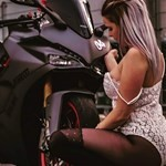 Women Ducati 939 SuperSport, a woman sitting on a motorcycle a woman sitting on a Ducati 939 SuperSport Sportbike