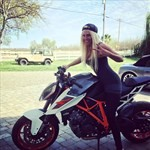 Women KTM Duke Series, a person riding on the back of a motorcycle a person riding on the back of a KTM Duke Series Sportbike