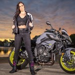 Women Yamaha MT-10, a person riding on the back of a motorcycle a person riding on the back of a Yamaha MT-10 Sportbike