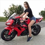 Women Honda CBR1000RR, a woman wearing a red and black motorcycle a woman wearing a red and black Honda CBR1000RR Sportbike