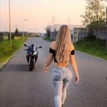 Women BMW S1000RR, a young girl riding a skateboard down the side of a road