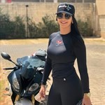 Women BMW S1000RR, a person standing next to a motorcycle a person standing next to a BMW S1000RR Sportbike