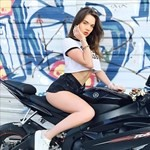 Women Yamaha YZF-R6, a woman sitting on a motorcycle