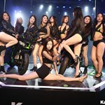 Women Kawasaki Ninja ZX-10R, a group of people sitting on a stage posing for the camera