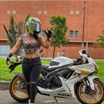 Women Suzuki GSX-R750, a woman sitting on a motorcycle in front of a building