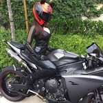 Women Yamaha YZF-R1, a person sitting on a motorcycle a person sitting on a Yamaha YZF-R1 Sportbike