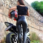 Women Yamaha YZF-R6, a woman sitting on a motorcycle a woman sitting on a Yamaha YZF-R6 Sportbike