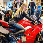 Women Ducati Panigale V4, a red and black motorcycle a red and black Ducati Panigale V4 Sportbike