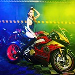 Women Ducati Panigale V4, a person sitting on a motorcycle a person sitting on a Ducati Panigale V4 Sportbike