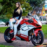Women Ducati Panigale V4, a person riding on the back of a motorcycle a person riding on the back of a Ducati Panigale V4 Sportbike