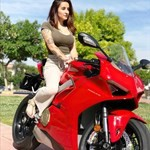 Women Ducati Panigale V4, a woman riding on the back of a motorcycle a woman riding on the back of a Ducati Panigale V4 Sportbike