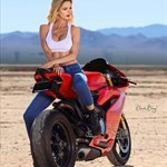 Women Ducati 899/959 Models, a person sitting on a motorcycle a person sitting on a Ducati 899/959 Models Sportbike