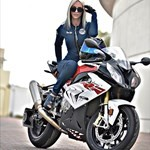 Women BMW S1000RR, a person riding on the back of a motorcycle a person riding on the back of a BMW S1000RR Sportbike