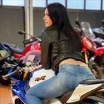 Women BMW S1000RR, a woman sitting on a motorcycle a woman sitting on a BMW S1000RR Sportbike